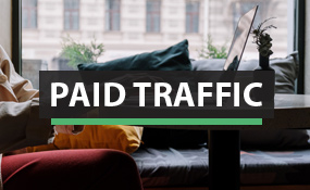 Paid Traffic with woman at computer background